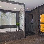 Bathroom With Bathtub, Shower Without Door, Dark Mosaic Tiles On Flooring, Wall, Metal Shower Fixture