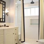 Bathroom With Shower With No Door, With White Curtain, White Subway Tiles On The Wall, White Hexagonal Tiles On The Floor, White Vanity And Cabinet