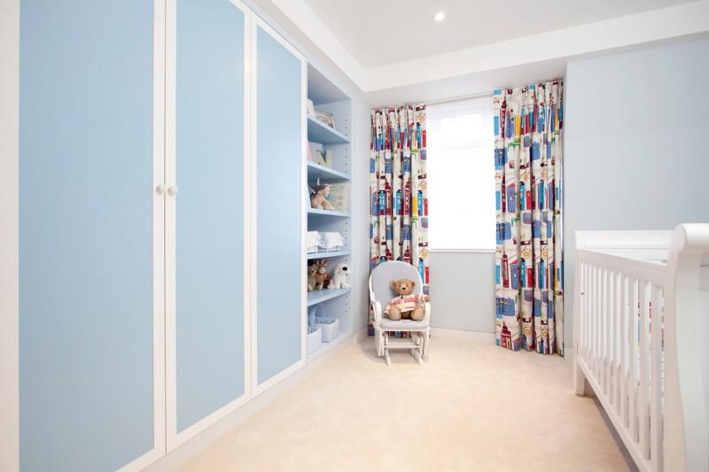 blue cupboard colored curtains teddy bear blue wall white crib white wall cream rug children chair