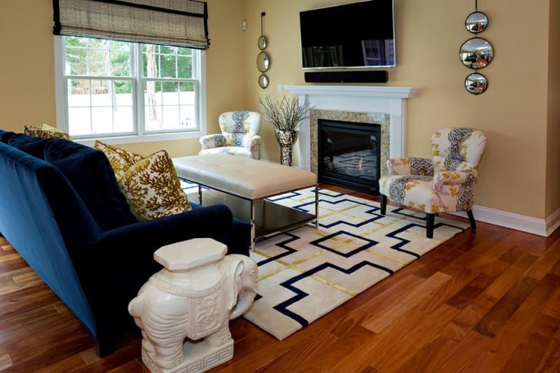blue velvet sofa identical blue accent chairs rectangular rug hardwood floor cream wall curtain shade pillow throw rectangular table