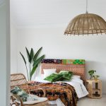 boho chic furniture bed small table chair book pillows decorative plants tropical bedroom