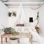boho chic furniture bench small table bed shelf plants pillows carpet basket bedroom