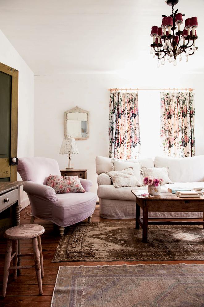 boho chic furniture carpet hardwood floor stool armchair sofa pillows mirror lamp window curtain table living room flowers chandelier