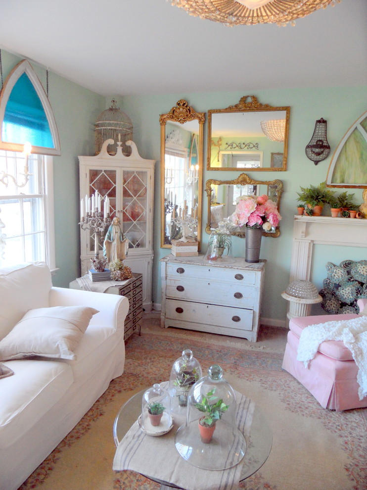 boho chic furniture glass top table sofa drawers flowers mirrors pillow family room