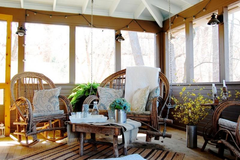 boho chic furniture lamps interesting chairs low table carpet decorative plants big windows rustic porch