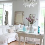 boho chic furniture table chair violin sofa pillows chandelier flowers living room