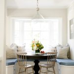 Breakfast Nook Benches Giant Light Bulb Round Table Tall Back Chairs Throw Pillows Flower Centerpiece Harwood Floors Traditional Design
