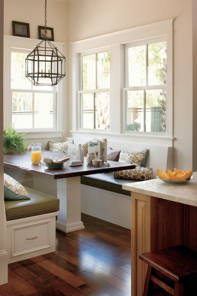 breakfast nook benches throw pillows geometrical pendant wood countertops dining table stool island hardwood floors traditional design