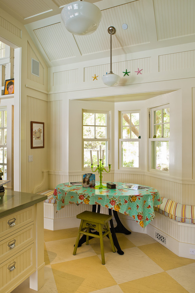 breakfast nook benches white pendants covered table stool recessed panel cabinets wall decorations ceramic floors white walls farmhouse style
