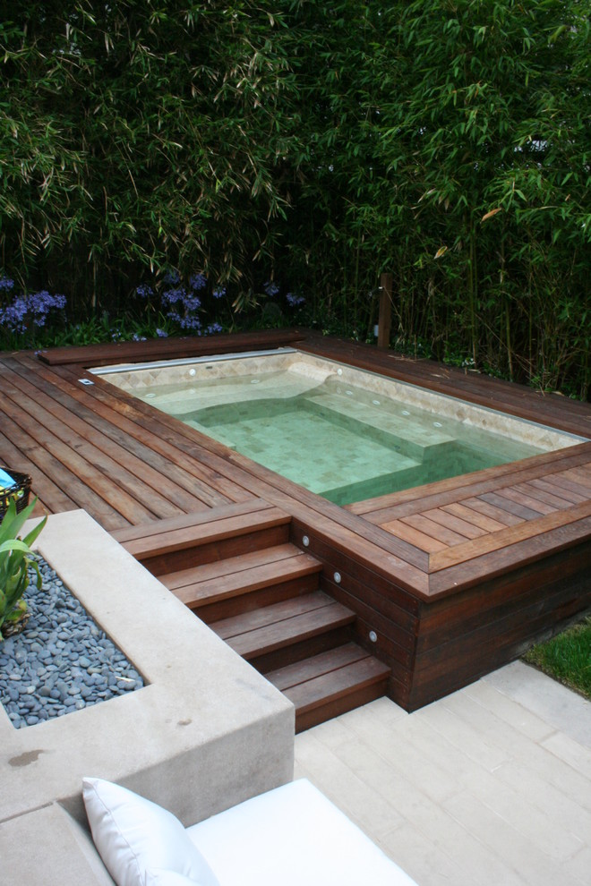 built in hot tub in wooden deck lpe with bluestone inside the tub