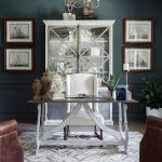 calypso home furniture freestanding desk tall back chairs couches chandelier wall paintings carpet glass front cabinet decorations transitional design