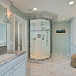 carrera marble bathroom undermount sink raised panel cabinets stone slab granite countertop single sink faucet couch alcove shower one piece toilet traditional design