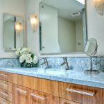 Carrera Marble Bathrooms Basket Weave Backsplash Mirrors Wall Lamps Wide Sink Double Faucets Wooden Cabinets Blue Countertop Traditional Design