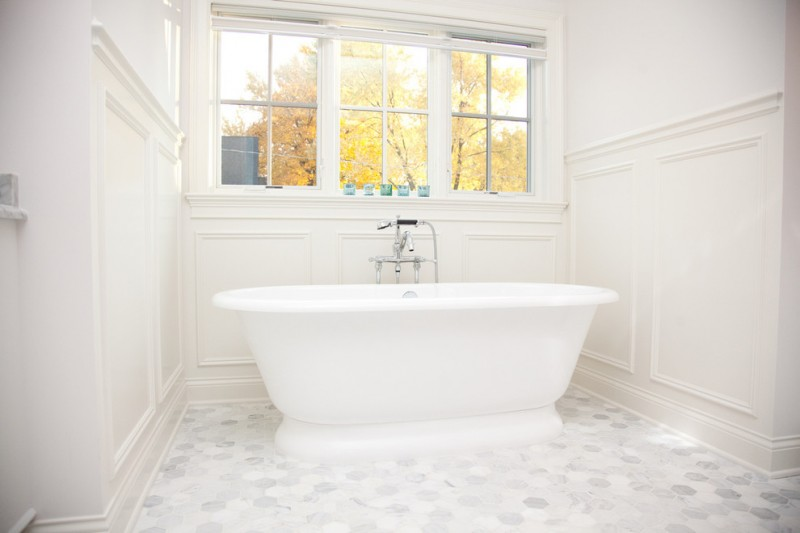 carrera marble bathrooms freestanding tub multiple windows subway tiles white walls shower faucets lights traditional design
