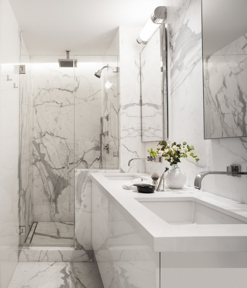 carrera marble bathrooms undermount sink floating cabinets white tiles alcove shower glass door wall lamps mirrors contemporary style