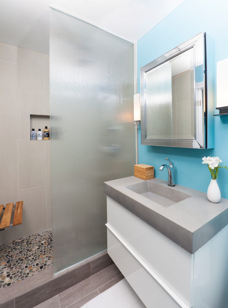 clean & colorful bathroom idea blue wall floating white vanity concrete composit countertop undermount concrete sink blurred glass door panel mosaic stones floors grey ceramic tiles shower walls
