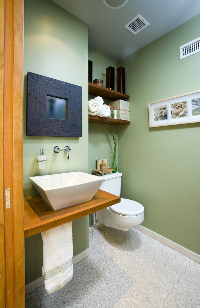 contemporary bathroom design with green walls blue ceiling white sink wall mount one piece toilet in white wood wall mount shelves black framed mirror
