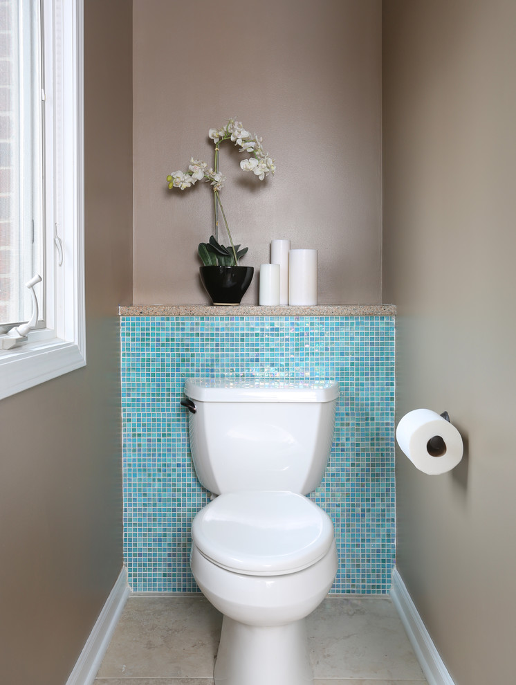 contemporary bathroom with turquoise mosaic tiles wall panel neutral beige walls wall mounted two piece toilet in white beige floors
