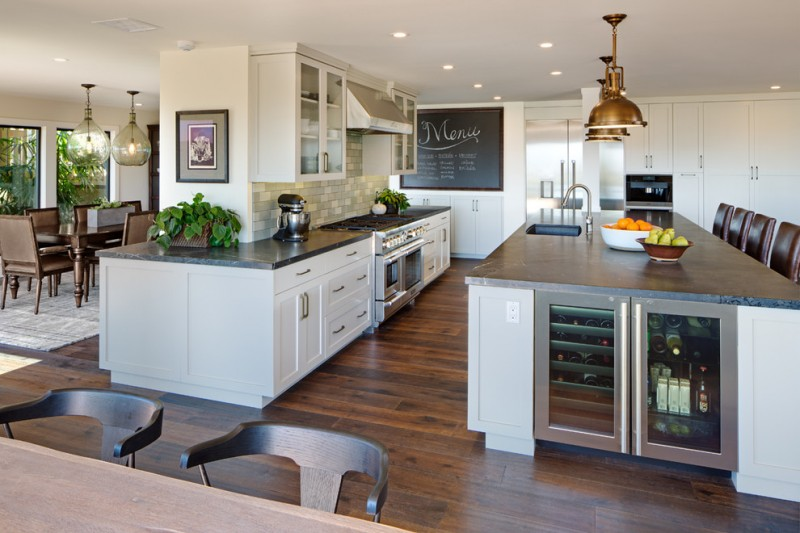 contemporary kitchen idea with i shaped black countertop white cabinets glass door upper cabinets granite top kitchen island with undermount sink and glass door cabinets dark hardwood floors