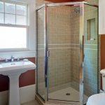 Craftsman Bathroom Idea With Corner Shower Space Beige Ceramic Tiles Walls Small White Ceramic Floors Glass Door Panels White Pedestal Sink Two Piece Toilet In White