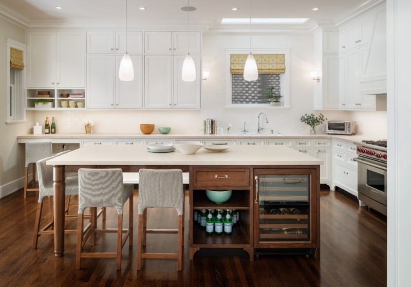 custom made kitchen islands flat panel cabinets granite countertops low back chairs built in racks undermount sink pendants hardwood floors white backsplash transitional design