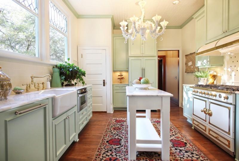 custom made kitchen islands french door fridge granite countertops chandelier cupboard kitchenette raised panel cabinets hardwood floors carpet traditional design