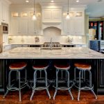 Custom Made Kitchen Islands Marble Countertops Modern Pendants Wall Cabinets Bar Stools Single Hole Sink Stainless Steel Appliances Hardwood Floors Traditional Design