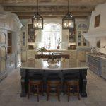 Custom Made Kitchen Islands Marble Countertops Recessed Panel Cabinets Standing Shelves Wall Racks Stools Pendants Undermount Sink Ceramic Tiles Rustic Design