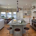 Custom Made Kitchen Islands Shaker Cabinets Farmhouse Sink Granite Countertop Round Dining Table Stools Tall Back Chairs Chandelier Pendants Paneled Appliances Kitchenette Traditional Design
