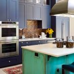 Custom Made Kitchen Islands Shaker Cabinets Wall Lamps Undermount Sink Stainless Steel Appliances Multicolored Backsplash Carpet Ceramic Tiles Stool Eclectic Design