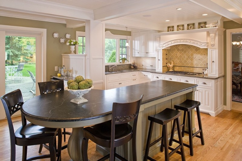 custom made kitchen islands soapstone countertop yellow backsplash stools low back chairs ceiling lights raised panel cabinets kitchenette wall decorations light hardwood floors traditional design