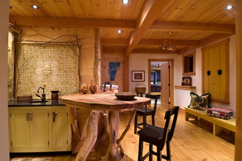custom made kitchen islands soapstone countertops ceramic backsplash undermount sink shaker cabinets ceiling lights stools built in bench hardwood floors eclectic design