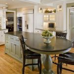 Custom Made Kitchen Islands Soapstone Countertops Raised Panel Cabinets Round Dining Table Tall Back Chairs Double Bowl Sink Light Hardwood Floors Ceiling Lights Kitchenette Traditional Design