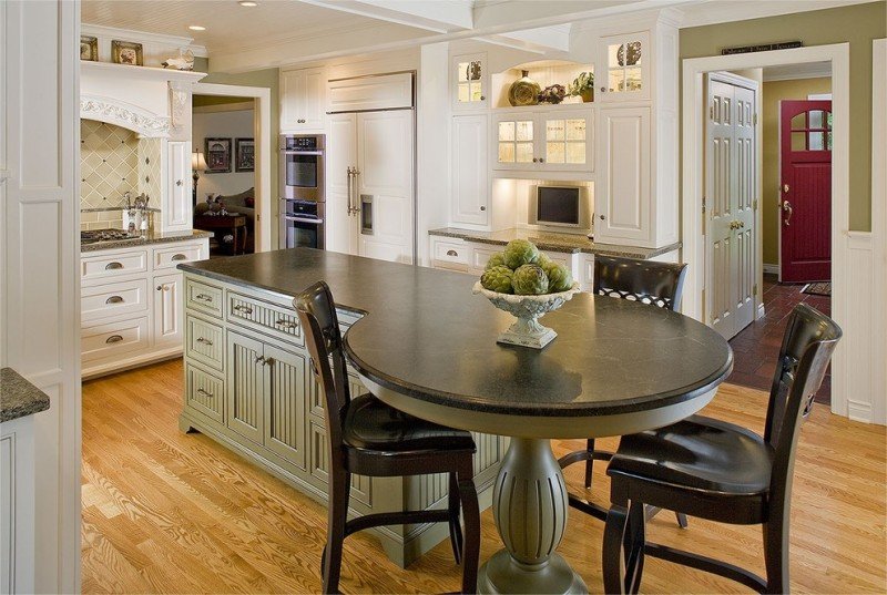 custom made kitchen islands soapstone countertops raised panel cabinets round dining table tall back chairs double bowl sink light hardwood floors pendants kitchenette traditional design