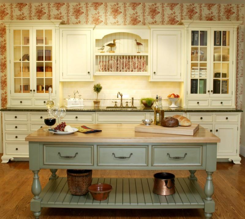 custom made kitchen islands white cabinetry undermount sink wood countertop rasied panel cabinets wallpaper hardwood floors subway tile backsplash farmhouse style