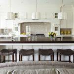 Custom Made Kitchen Islands Wood Cabinets White Pendants Recessed Panel Cabinets Undermount Sink Grey Backsplash Stools Hanging Rack Transitional Design