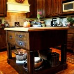 custom made kitchen islands wood countertops white backsplash raised panel cabinets drawers kitchenette hardwood floors traditional design