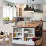 custom made kitchen islands wooden countertop shaker cabinets undermount sink wooden table stools black pendants subway tiles backsplash hardwood floors transitional design