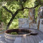 Cylinder Redwood Barrel On Wooden Deck In A Garden