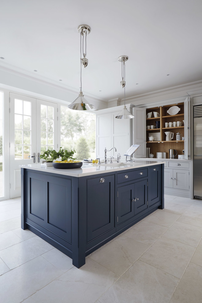 dark blue kitchen island with white marble top and shaker cabinets simple metal pendant lamps white ceramic tiles floors