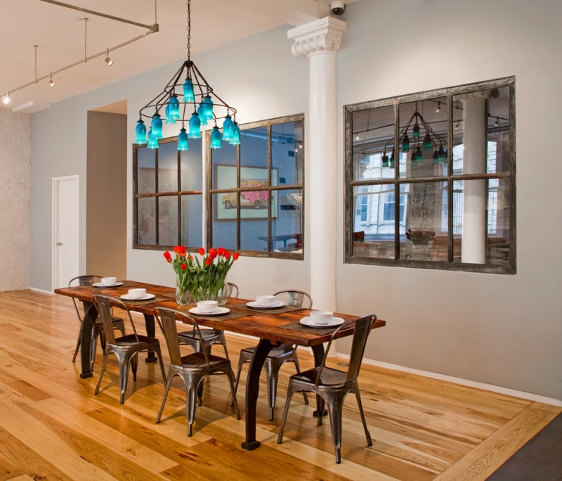decorative mirrors for dining room chandelier light fixtures narrow wood table tall back chairs beige walls hardwood floors industrial design