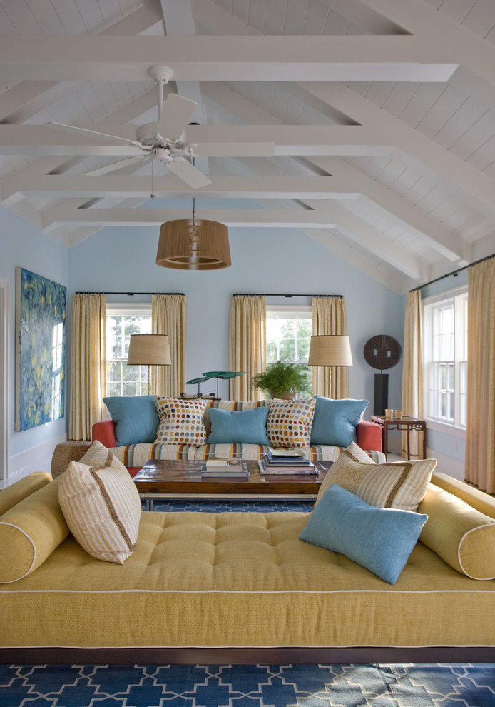 enclosed living room idea light blue walls white ceiling light yellow settee colorful pillows wood center table area rug with modern motifs