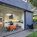 Exterior Pocket Doors Contemporary Kitchen Nelson Pendant Lamp Brown Caf Chair Mosaic Tiles