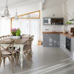 farm style kitchen table chairs cabinet lamps shelf faucet curtains decorative plants farmhouse style room