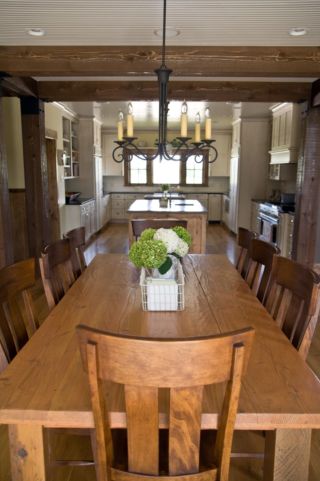 farm style kitchen table chairs flowers ceiling lights chandelier wall cabinets window farmhouse style room