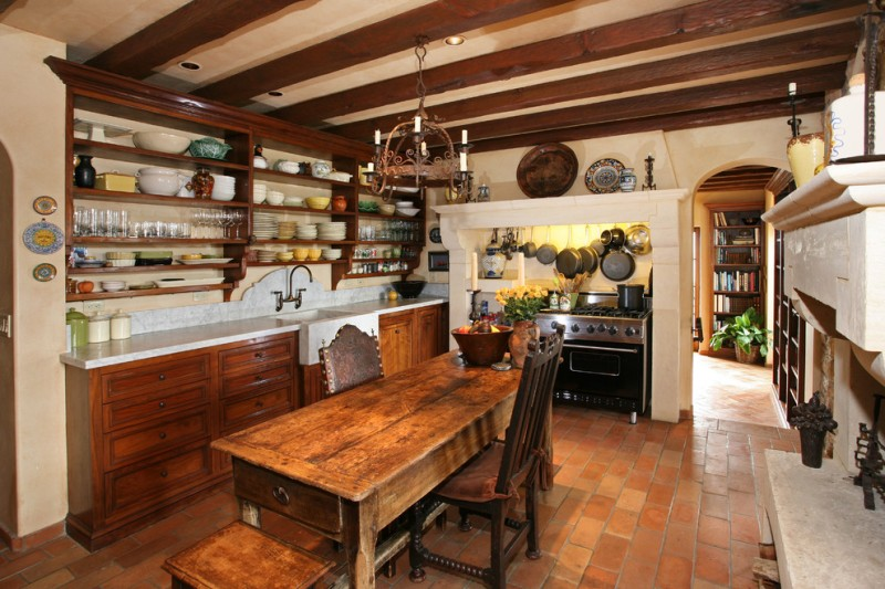 farm style kitchen table chairs shelves appliances chandelier stove drawers cabinet faucet sink