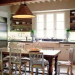 farm style kitchen table chairs windows shelves hanging lamp decorations faucet cabinets drawers farmhouse room