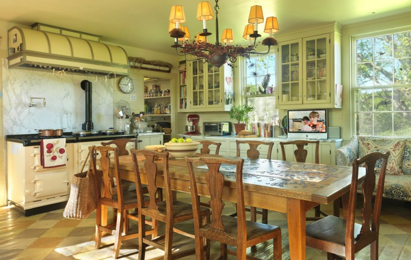 farm style kitchen table chairs windows wall cabinets clock chandelier stove books decorative plants farmhouse room
