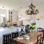 Farm Style Kitchen Table Flowers Chandelier Window Faucet Sink Island Chairs Stools Wall Cabinets Traditional Style Room