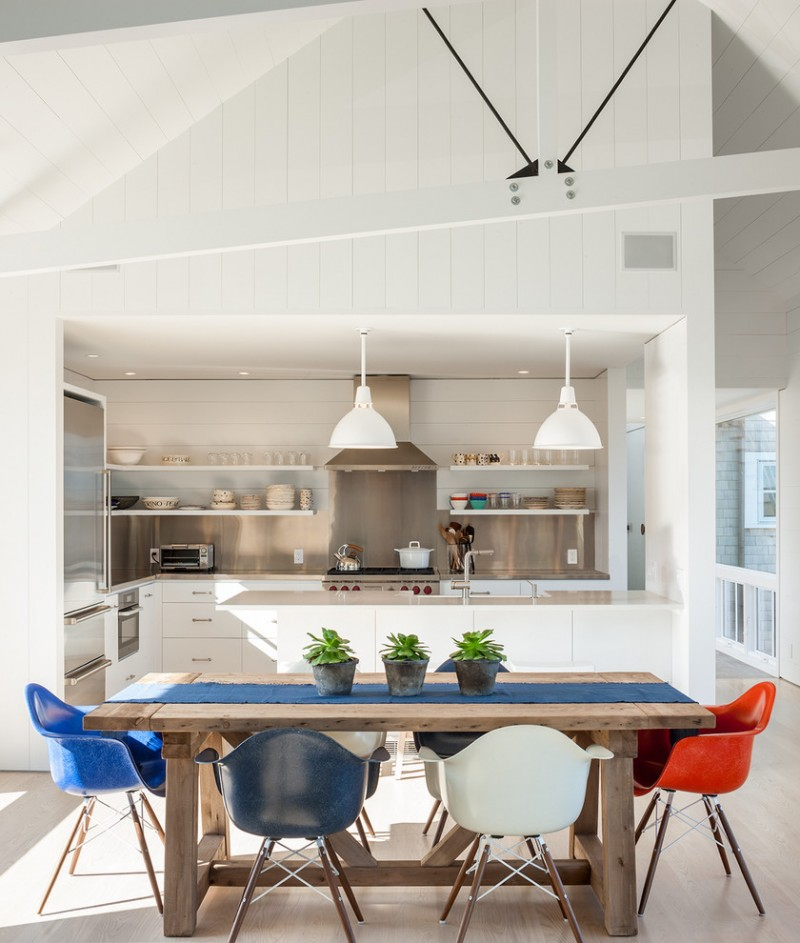 farm style kitchen table modern chairs cloth decorative plants shelves stove pendant lights beach style room